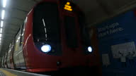 Interior slow motion shot London Underground train pulling into Underground station on May 14 2015 in London England