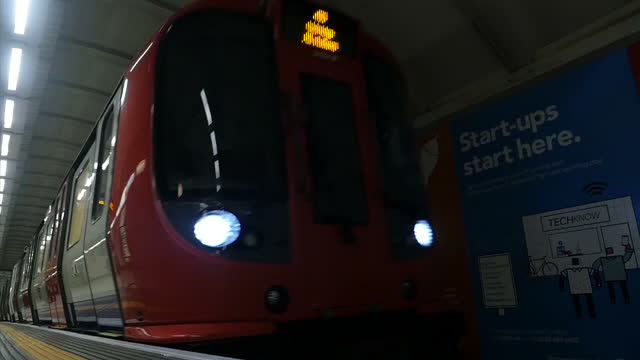 Interior slow motion shot London Underground train pulling into Underground station on May 14 2015 in London England