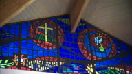 Interior stained glass panel near roof w/ Christian cross Greek lettering Alpha Omega dove ZO Wider roof arch panel Prison not jail correctional...