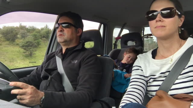 Interior view of a family drives together in a car