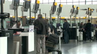Interior wide shots passengers checking in luggage at Heathrow Airport on February 21 2015 in London England