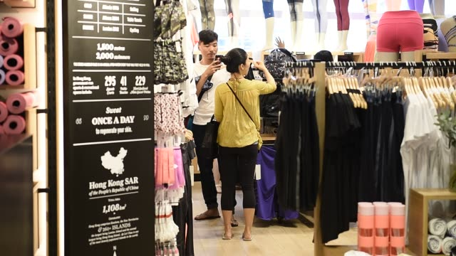 Interiors of a Lululemon Athletica shop at IFC Hong Kong in Hong Kong China on June 22 2015 Shots CU shift focus of row of leggingswide shot of...