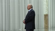 Interiors of Belarus President Alexander Lukashenko arriving down staircase and standing ready to greet guests on February 11 2015 in Minsk Belarus