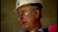 Interiors of Prince Charles Duke of Cornwall wearing goggles hard hat and hivis jacket talking to members of staff at Lee Tunnel and Abbey Mills...