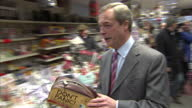 Interiors of UKIP leader Nigel Farage in newsagents and trying to buy item and being given it for free on February 12 2015 in Canvey Island England