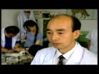 Interiors Pekingese dogs in vet surgery Interiors doctor looking at doggy xray Interior interview Chen Wu Beijing Animal Hospital Interiors dogs...