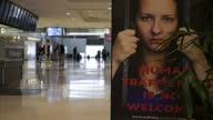 Internal shots HartsfieldJackson Atlanta International Airport people walking in background with antisex trafficking sign saying HUMAN TRAFFICKING IS...