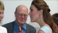 Internal shots of Catherine Duchess of Cambridge speaking to guests near Marc Quinn's frozen blood sculpture 'Self' at a reception for the Art Room...