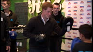 Internal shots of Prince Harry meeting young boxers at boxing school during visit to Rssell Yoth Club in Nottingham putting on pads and doing some...
