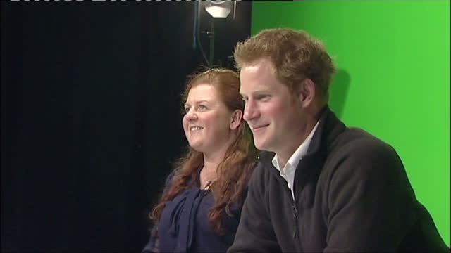 Internal shots of Prince Harry sitting down at presenters' desk in television studio for media opportunity at the Confetti Institute of Creative...