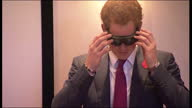 Internal shots of Prince Harry trying on pair of google and walking through course of cones to simulate difficulties of having a brain injury during...