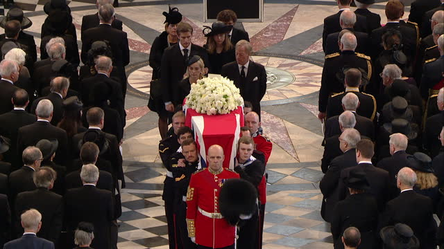 Internal shots of the coffin of the late Baroness Thatcher draped in the Union flag being carried down the aisle of St Paul's Cathedral by military...
