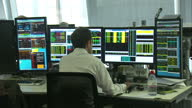 Internal shots of traders on the Panmure Gordon Trading Floor Shows interior shots of anonymous Trader working at his desk on December 17 2014 in...