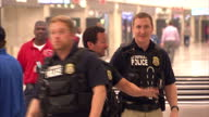 Internal shows Police officers with guns in Dulles International airport at Dulles International Airport on October 06 2014 in Dulles Virginia