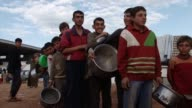 Internally displaced Syrians at the Bab al Salam camp wait for their daily food distribution CLEAN Growing number of displaced Syrians on April 19...