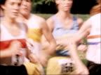 International female marathon race in London ENGLAND London Battersea Park EXT Starter holds up gun / Starter fires gun PULL OUT mass of people at...