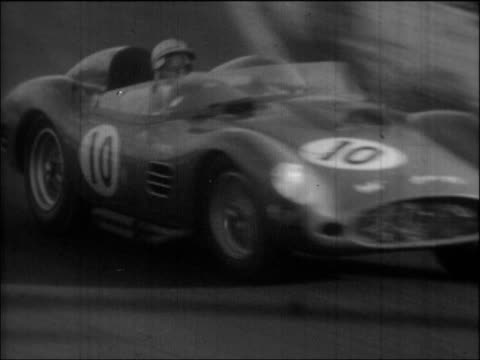 panning TLS/LS/MSs Grand Prix sports cars including Stirling Moss in Maserati Rodger Ward in Pedro Rodriguez in Ferrari racing through rural setting...
