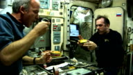 International Space Station Expedition 13 astronauts Jeff Williams and Pavel Vinogradov show what living in zero gravity is like / astronauts shaving...