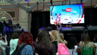YouTube 'Summer in the City' convention at Alexandra Palace Unidentified pop singer performing song on stage SOT
