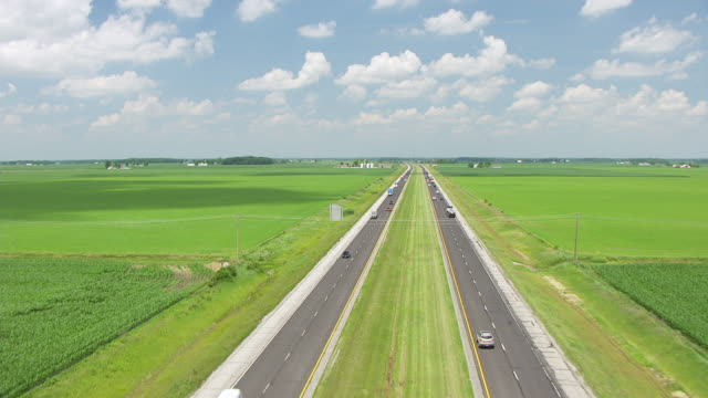 WS TU AERIAL POV Interstate 69 passing through farmlands / Huntington County, Indiana, United States