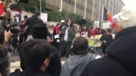Protesters rally at the Edward R Royball Federal Building in downtown Los Angles