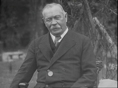 Interview with author Sir Arthur Conan Doyle discussing his long fascination with spiritualism / interview is conducted outside his home Sir Arthur...