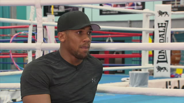 Interview with British professional boxer Anthony Joshua on former footballer Rio Ferdinand taking up boxing at English Institute of Sport Sheffield...