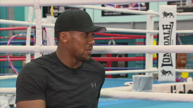 Interview with British professional boxer Anthony Joshua on having a normal life outside the ring and interacting with fans at English Institute of...