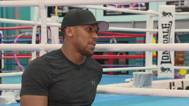 Interview with British professional boxer Anthony Joshua on still having hunger for success in boxing but now smarter in his decisions and on whether...