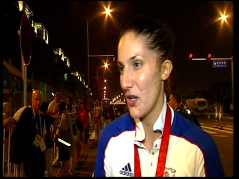 Interview with bronze medallist Sarah Stevenson CHINA Beijing EXT / NIGHT Sarah Stevenson along to press using crutches includes close up of bronze...