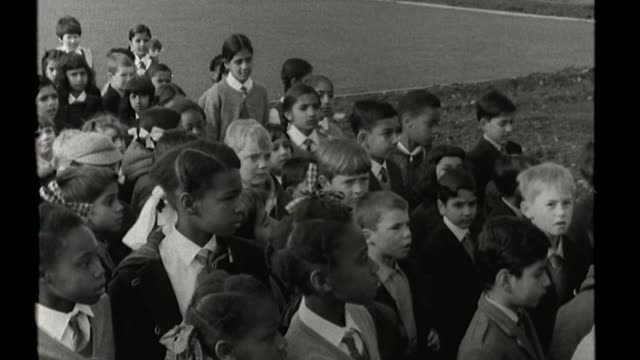 Interview with West Midlands' first black MP Eleanor Smith FS050968114 / TX 591968 Wolverhampton Children arriving at Grove Junior School B/W Teacher...