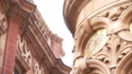 Intricate carvings adorn the exterior of Victorian buildings in Leeds. Available in HD.