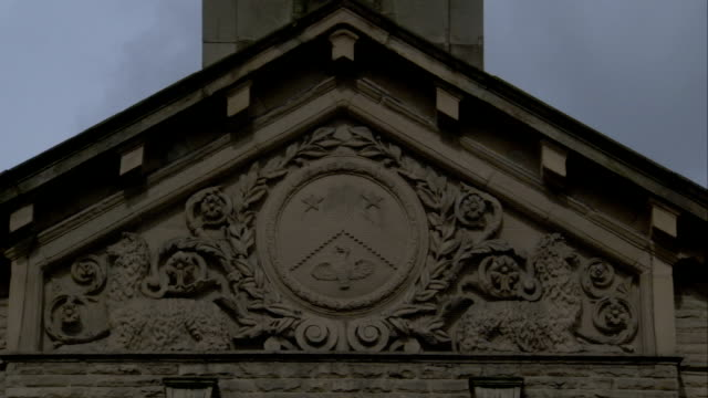 Intricate stone carvings above doorway, Saltaire. Available in HD.