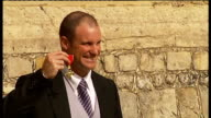 Andrew Strauss receives OBE ENGLAND Berkshire Windsor Castle EXT Andrew Strauss posing with his OBE for photocall Photographers Strauss posing with...