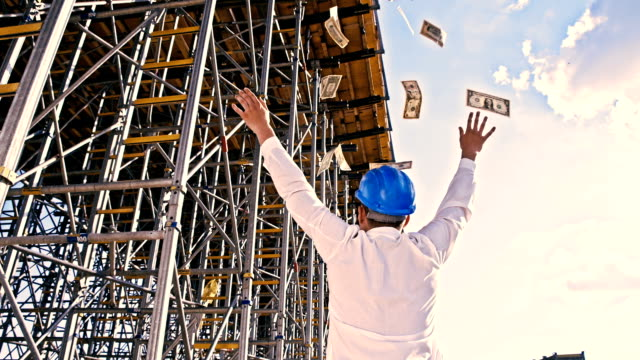 SLO MO Investor throwing money up at construction site