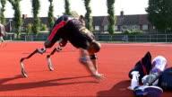 Derenalagi putting racing blades on prosthetic limbs Lance Corporal Derek Derenalagi saying 'nice' SOT Derenalagi doing push up to get up...