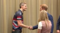 Prince Harry arrives in Toronto INT Prince Harry along greeting Invictus athletes Close shot Prince Harry