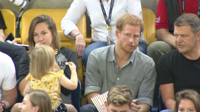 Prince Harry attends volleyball match CANADA Ontario Toronto INT Various shots Prince Harry seated at volleyball match and Emily Henson taking...