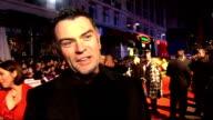 'Invictus' UK film premiere Cast interviews on red carpet Julian LewisJones speaking to reporters / Julian Lewis Jones interview SOT On it being a...