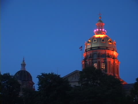 Iowa Capitol's Golden Dome Against A Twilight Sky