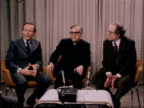 US clergymen depart for Tehran ENGLAND London Airport EXT Three clergymen walk towards Three clergymen along inside departure lounge Three seated for...