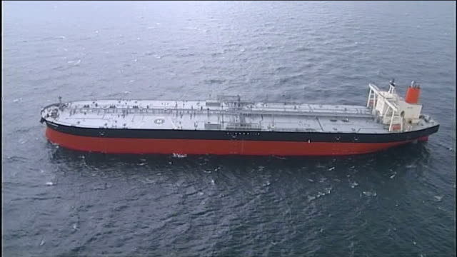 Iran threatens to close Strait of Hormuz after diplomatic row with EU AERIALs oil tanker along in Gulf AERIALs naval vessels along AERIALs oil tanker