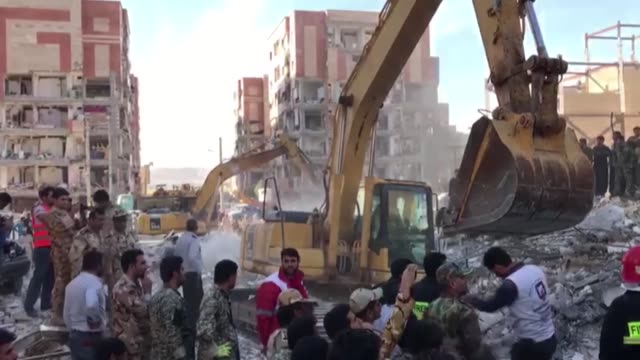 Iranian officials search for survivors in the rubble of buildings a day after a powerful 73 earthquake struck the city of Kermanshah Iran on November...