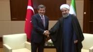 Iranian President Hassan Rouhani meets Turkish Prime Minister Ahmet Davutoglu at JW Marriott Hotel in Ankara Turkey on April 15 2016
