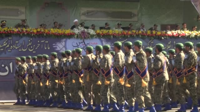 Iranian troops walk past Iranian military commanders during the annual military parade marking the anniversary of the start of Iran's 19801988 war...