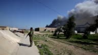 Iraqi army soldiers and Shiite fighters from the Popular Mobilisation units were patrolling on Monday around an army position where an attack was...