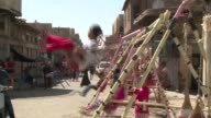 Iraqi children were celebrating in the streets of the capital Baghdad on Friday on the second day of the Eid alAdha Feast of the Sacrifice a holiday...