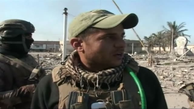 Iraqi forces are seen as they reseized the Ramadi centrum from after an operation in Ramadi Iraq on December 28 2015 A soldier of Iraqi forces speaks...