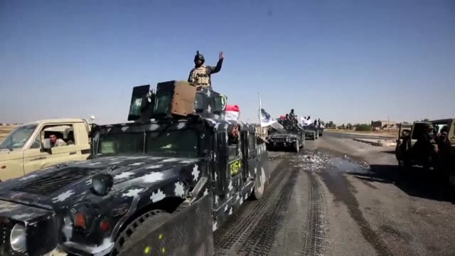 Iraqi forces seized a key military base an airport and an oil field from Kurdish fighters Monday in disputed Kirkuk province in a major operation...