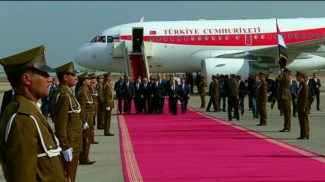 Iraqi Foreign Minister Ibrahim alJaafari welcomes Turkey's Prime Minister Ahmet Davutoglu at Baghdad International Airport on November 20 2014 in...